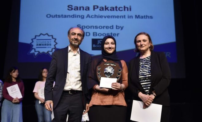 Winner Sana Pakatchi (in the middle) receiving the award, standing to the right is Parvaneh Alinaghian, Head of Maths Curriculum at the Harrow College.